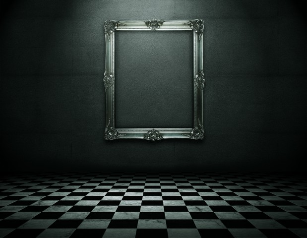 ornate-silver-frame-in-dark-room.jpg