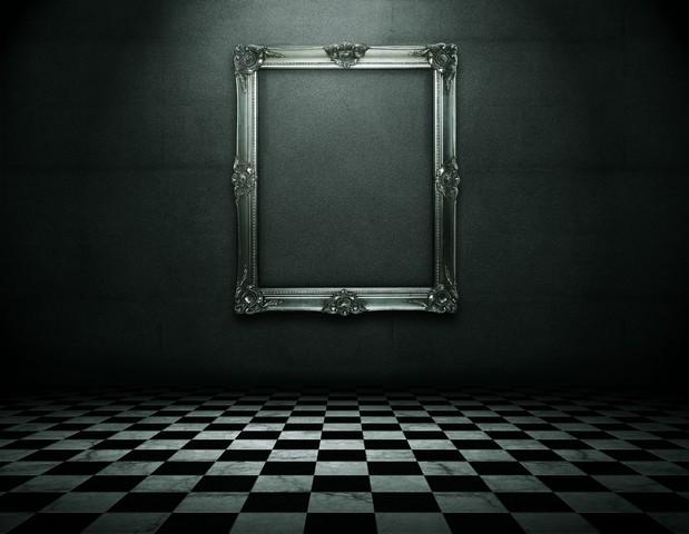 ornate-silver-frame-in-dark-room.jpg
